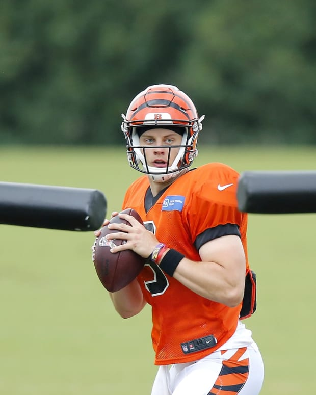 Aug 21, 2020; Cincinnati, Ohio, USA; Cincinnati Bengals rookie quarterback Joe Burrow (9) runs through passing drills during training camp at the teams practice facility. Mandatory Credit: Joseph Maiorana-USA TODAY Sports