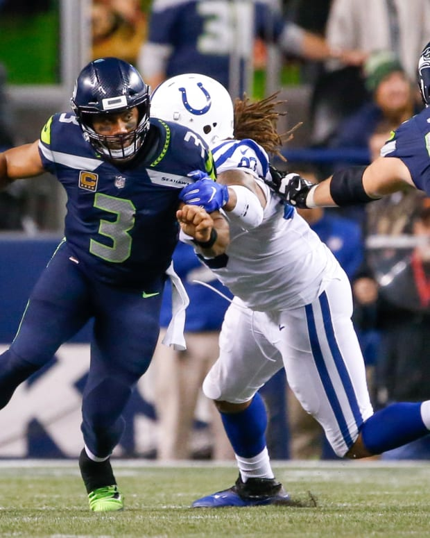 Oct 1, 2017; Seattle, WA, USA; Seattle Seahawks quarterback Russell Wilson (3) escapes from a sack by the Indianapolis Colts during the fourth quarter at CenturyLink Field. Mandatory Credit: Joe Nicholson-USA TODAY Sports