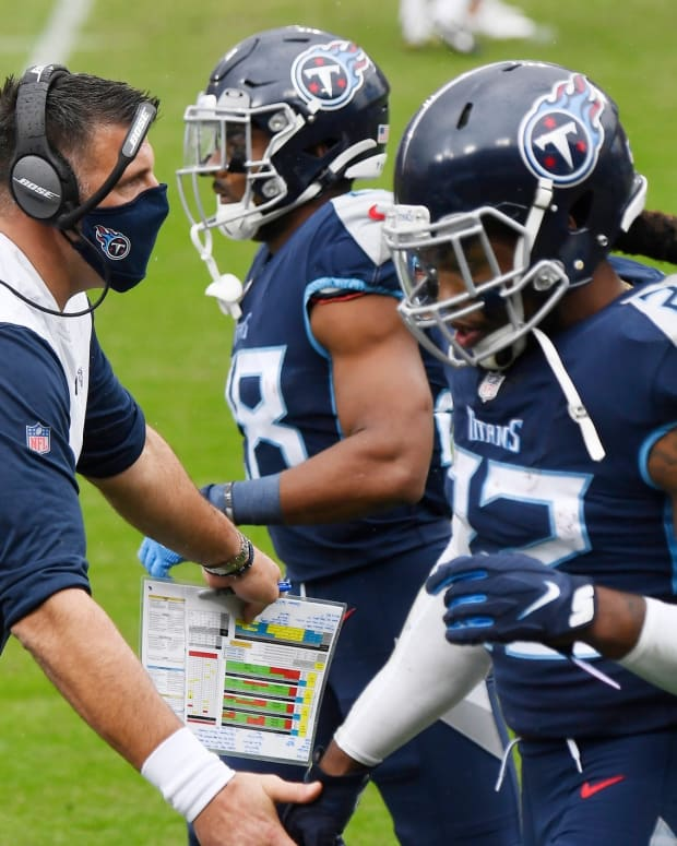 Tennessee Titans head coach Mike Vrabel congratulates players after the second touchdown in the first half against the Houston Texans at Nissan Stadium Sunday, Oct. 18, 2020 in Nashville, Tenn.