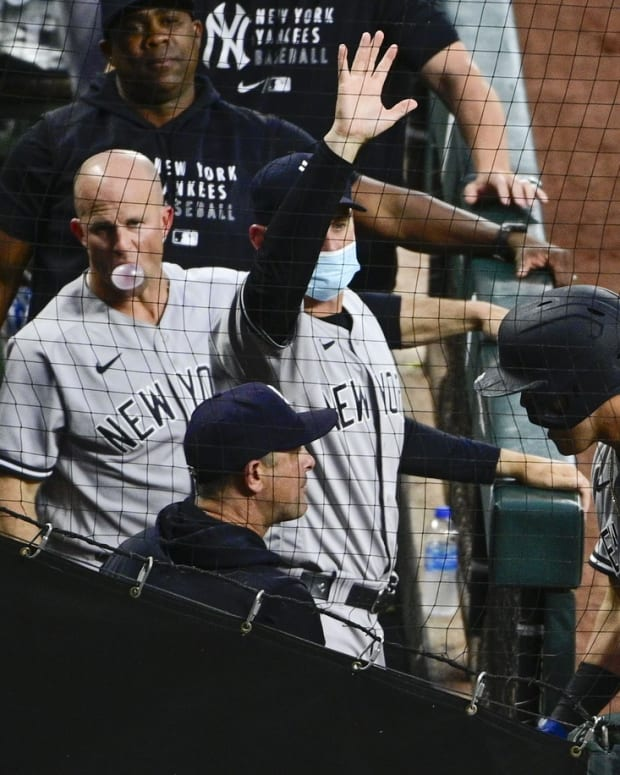 Gio Urshela celebrates in Yankees dugout