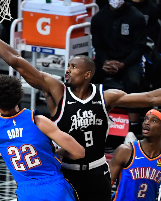 Jan 24, 2021; Los Angeles, California, USA; Oklahoma City Thunder forward Isaiah Roby (22) tries to score past LA Clippers center Serge Ibaka (9) dirge the third quarter at Staples Center. Mandatory Credit: Robert Hanashiro-USA TODAY Sports