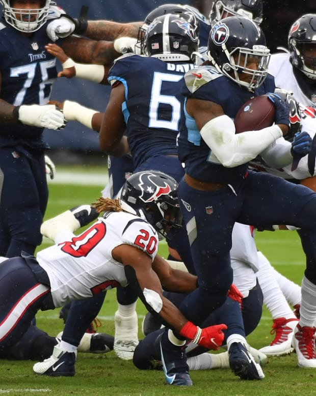 Tennessee Titans running back Derrick Henry (22) runs for a first down during the first half against the Houston Texans at Nissan Stadium.