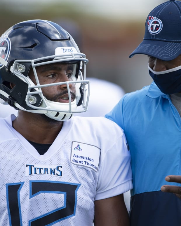 Tennessee Titans wide receiver Rashard Davis (12) talks with wide receivers coach Rob Moore during a training camp practice at Saint Thomas Sports Park Tuesday, Aug. 25, 2020 Nashville, Tenn.
