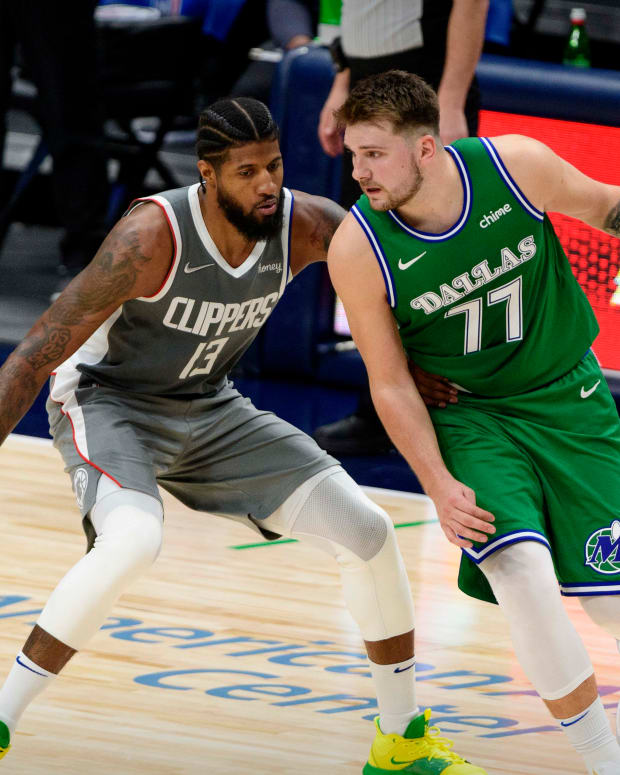 Mar 17, 2021; Dallas, Texas, USA; LA Clippers guard Paul George (13) and Dallas Mavericks guard Luka Doncic (77) in action during the game between the Dallas Mavericks and the LA Clippers at the American Airlines Center. Mandatory Credit: Jerome Miron-USA TODAY Sports