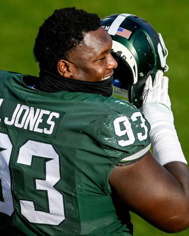 Michigan State's Naquan Jones talks with teammates on the sideline during the third quarter in the game against Indiana on Saturday, Nov. 14, 2020, at Spartan Stadium in East Lansing.