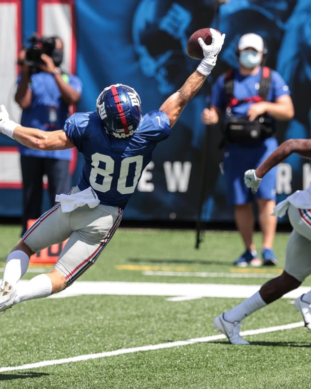 Sep 3, 2020; East Rutherford, New Jersey, USA; New York Giants wide receiver Alex Bachman (80) attempts to catch the ball in front of cornerback Corey Ballentine (25) during the Blue-White Scrimmage at MetLife Stadium.