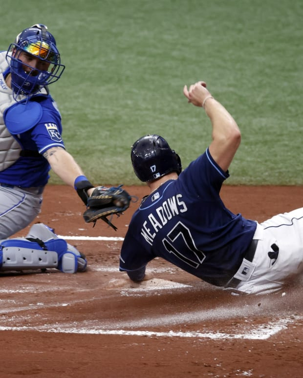 May 27, 2021; St. Petersburg, Florida, USA; Tampa Bay Rays designated hitter Austin Meadows (17) scores a run as he slides in safe at home plate ad Kansas City Royals catcher Cam Gallagher (36) attempted to tag him out during the first inning at Tropicana Field. Mandatory Credit: Kim Klement-USA TODAY Sports