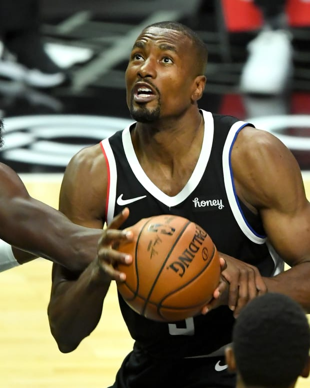 Dec 27, 2020; Los Angeles, California, USA; Los Angeles Clippers forward Serge Ibaka (right) is fouled by Dallas Mavericks guard Tim Hardaway Jr. (11) in the first half at Staples Center. Mandatory Credit: Jayne Kamin-Oncea-USA TODAY Sports