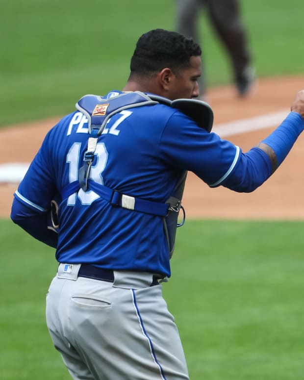 May 30, 2021; Minneapolis, Minnesota, USA; Kansas City Royals catcher Salvador Perez (13) and relief pitcher Greg Holland (35) celebrate their victory against the Minnesota Twins at Target Field. Mandatory Credit: David Berding-USA TODAY Sports