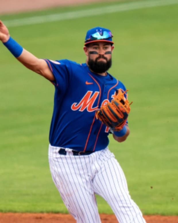 Mets infielder Luis Guillorme fires a throw to first base in a spring training game