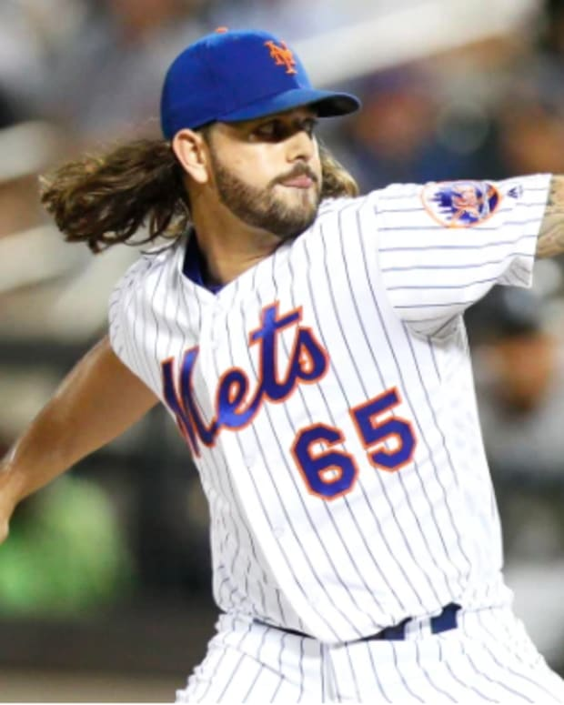 Mets relief pitcher Robert Gsellman fires home a pitch