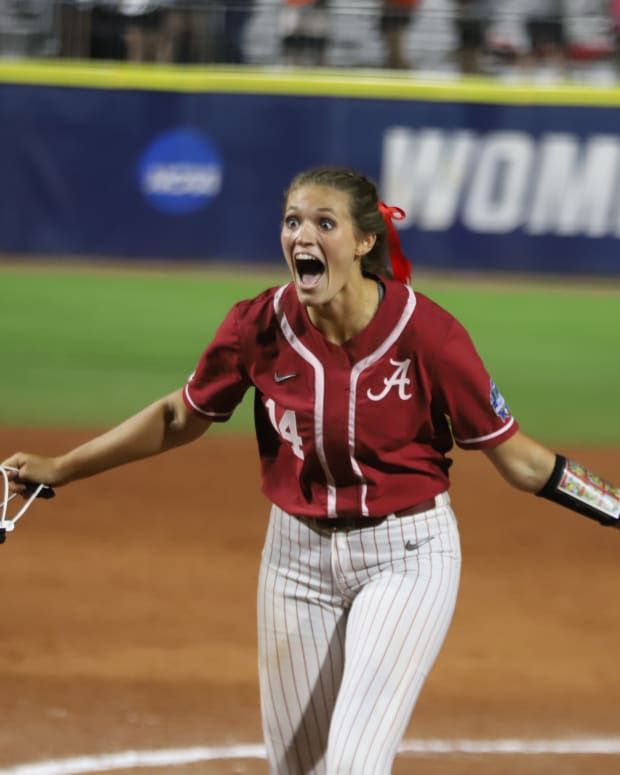 Montana Fouts celebrates a perfect game against UCLA in the WCWS on June 4, 2021.