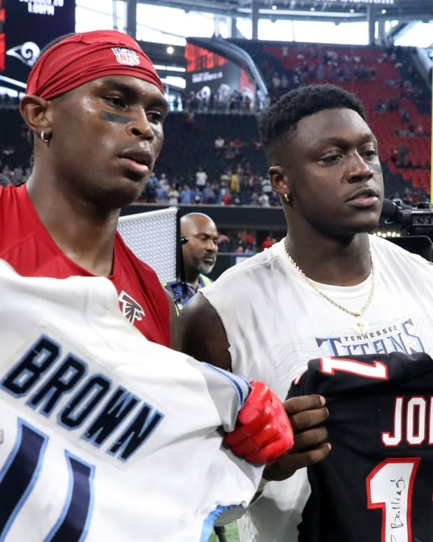 Atlanta Falcons wide receiver Julio Jones (11) and Tennessee Titans wide receiver A.J. Brown (11) pose with their jerseys after their game at Mercedes-Benz Stadium.