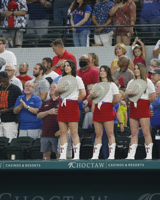 Jun 5, 2021; Arlington, Texas, USA; Texas Rangers mascot Captain and the Rangerettes stand during the playing of the national anthem in the seventh inning of a game against the Tampa Bay Rays at Globe Life Field.
