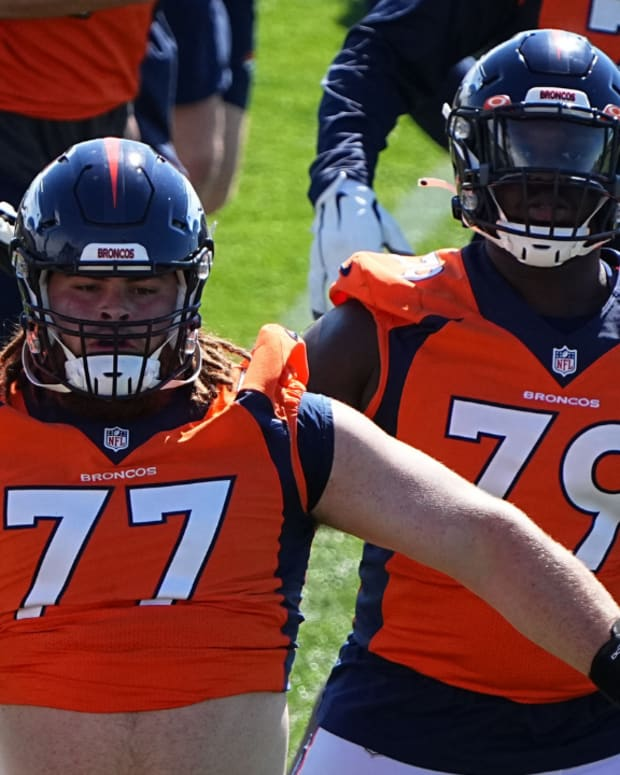 Denver Broncos lineman Cody Conway (60) and lineman Quinn Meinerz (77) and center Lloyd Cushenberry (79) during organized team activities at the UCHealth Training Center.