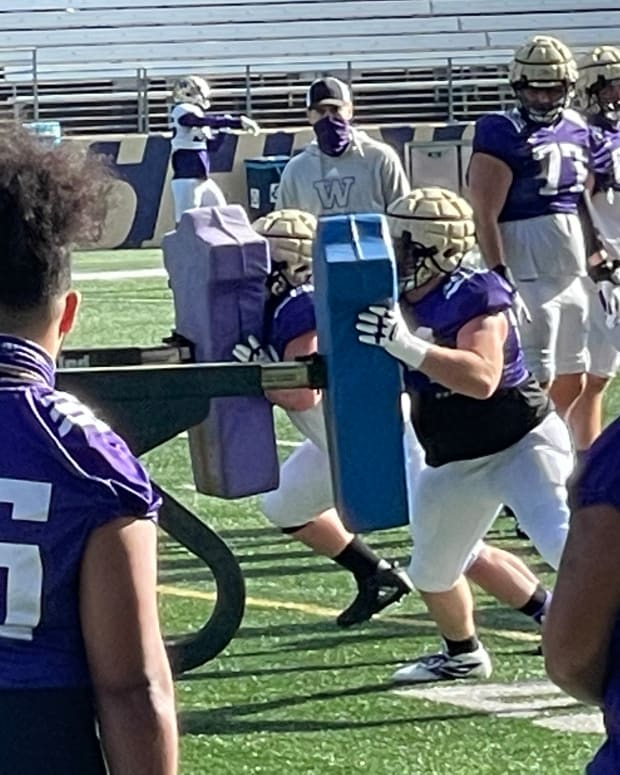 Husky offensive linemen take their turns on the sled.