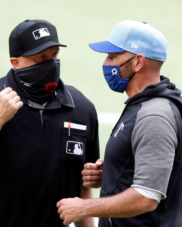 May 2, 2021; Arlington, Texas, USA; Texas Rangers manager Chris Woodward (8) talks to home plate umpire Brian O'Nora (7) about a call in the game against the Boston Red Sox at Globe Life Field.