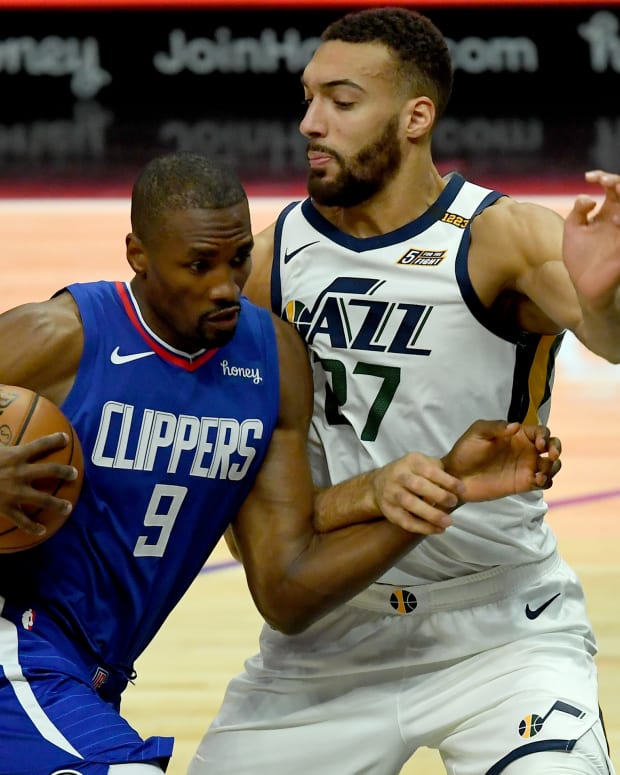 Feb 17, 2021; Los Angeles, California, USA; Los Angeles Clippers center Serge Ibaka (9) moves to the basket past Utah Jazz center Rudy Gobert (27) in the first half of the game at Staples Center. Mandatory Credit: Jayne Kamin-Oncea-USA TODAY Sports