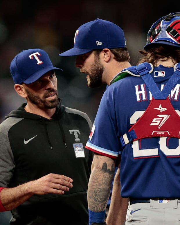 Jun 2, 2021; Denver, Colorado, USA; Texas Rangers starting pitcher Jordan Lyles (24) is pulled by manager Chris Woodward (8) ahead of catcher Jonah Heim (28) in the sixth inning against the Colorado Rockies at Coors Field.