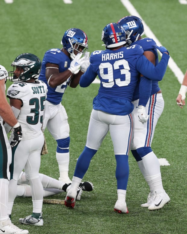 Nov 15, 2020; East Rutherford, New Jersey, USA; New York Giants linebacker Trent Harris (93) and safety Jabrill Peppers (21) celebrate a sack on Philadelphia Eagles quarterback Carson Wentz (11) during the second half at MetLife Stadium.