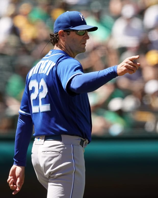 Jun 12, 2021; Oakland, California, USA; Kansas City Royals manager Mike Matheny (22) signals for a pitching change during the fifth inning against the Oakland Athletics at RingCentral Coliseum. Mandatory Credit: Darren Yamashita-USA TODAY Sports