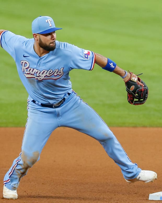 Jun 6, 2021; Arlington, Texas, USA; Texas Rangers third baseman Isiah Kiner-Falefa (9) turns an unassisted double play during the fifth inning against the Tampa Bay Rays at Globe Life Field.