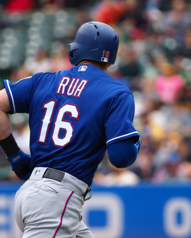 Apr 5, 2018; Oakland, CA, USA; Texas Rangers left fielder Ryan Rua (16) scores a run against the Oakland Athletics during the second inning at Oakland Coliseum.