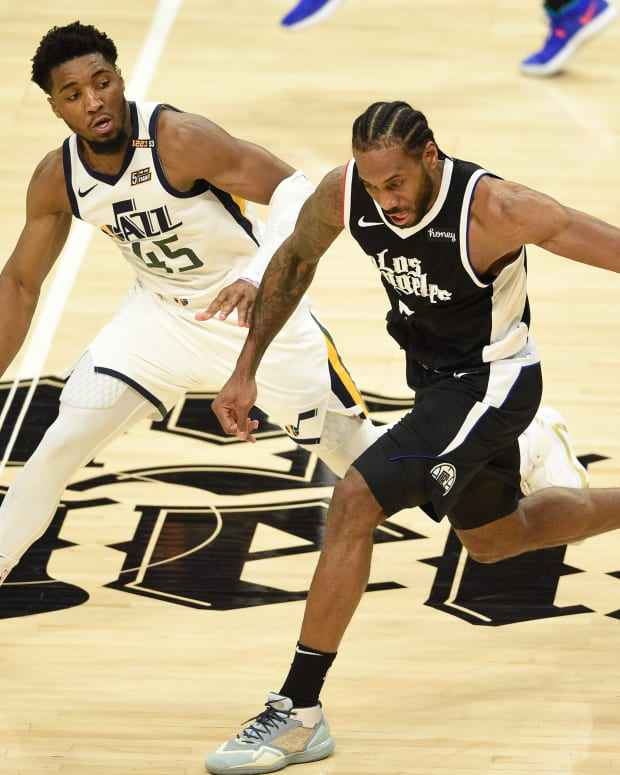 Jun 12, 2021; Los Angeles, California, USA; LA Clippers forward Kawhi Leonard (2) moves the ball while Utah Jazz guard Donovan Mitchell (45) defends in the third quarter during game three in the second round of the 2021 NBA Playoffs. at Staples Center. Mandatory Credit: Kelvin Kuo-USA TODAY Sports