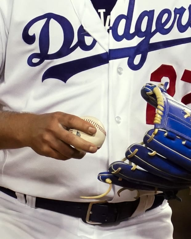 Jun 12, 2021; Los Angeles, California, USA; Los Angeles Dodgers starting pitcher Trevor Bauer grips the ball before throwing a pitch against the Texas Rangers in the seventh inning at Dodger Stadium.