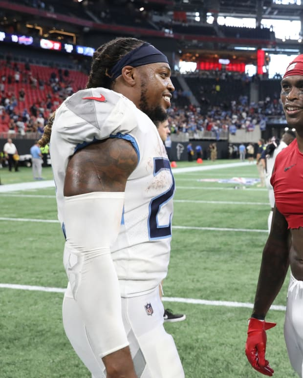 Tennessee Titans running back Derrick Henry (22) talks with Atlanta Falcons wide receiver Julio Jones (11) after their game at Mercedes-Benz Stadium.