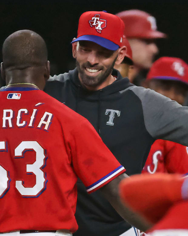 May 21, 2021; Arlington, Texas, USA; Texas Rangers center fielder Adolis Garcia (53) celebrates with manager Chris Woodward (8) after hitting a walk-off three run home run during the tenth inning to defeat the Houston Astros at Globe Life Field.