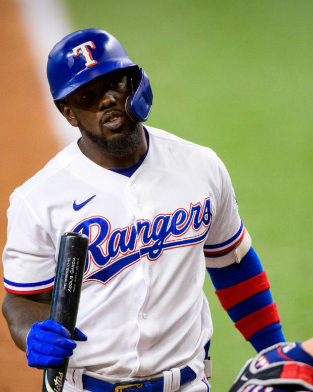 Jun 19, 2021; Arlington, Texas, USA; Texas Rangers center fielder Adolis Garcia (53) reacts to a called strike during the eighth inning against the Minnesota Twins at Globe Life Field.