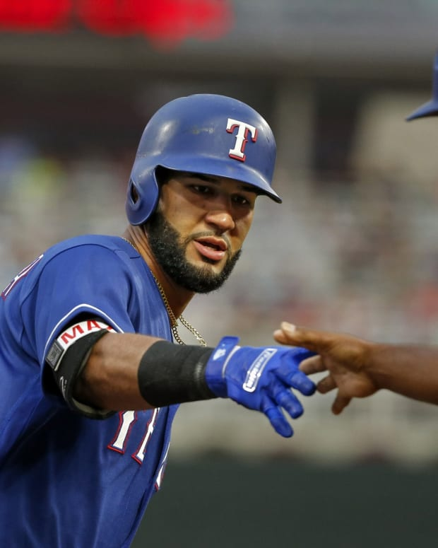 Aug 5, 2017; Minneapolis, MN, USA; Texas Rangers right fielder Nomar Mazara (30) celebrates with third base coach Tony Beasley after hitting a home run against the Minnesota Twins in the first inning at Target Field.