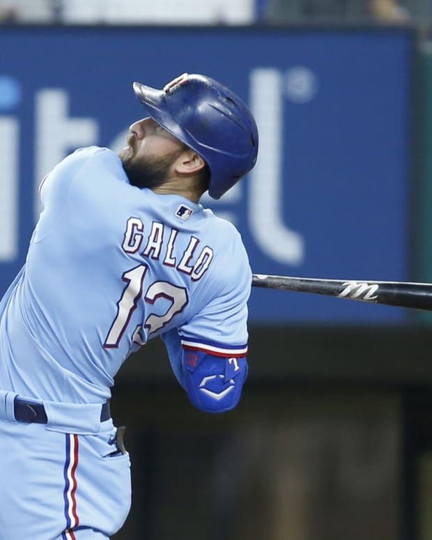 Jun 20, 2021; Arlington, Texas, USA; Texas Rangers right fielder Joey Gallo (13) follows through on a swing for a home run in the sixth inning against the Minnesota Twins at Globe Life Field.