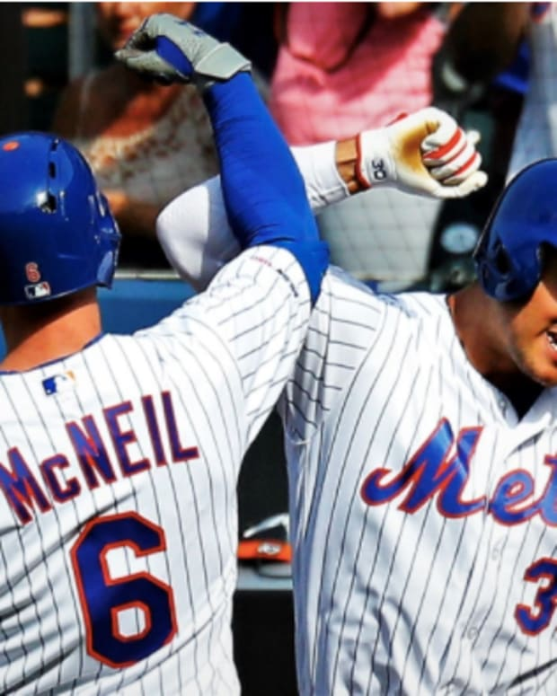 New York Mets' Jeff McNeil and Michael Conforto celebrate a home run