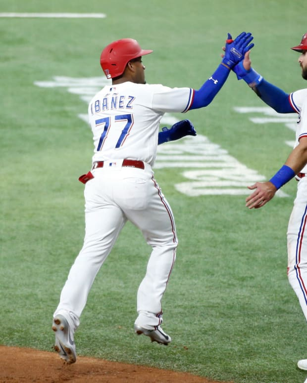 Jun 21, 2021; Arlington, Texas, USA; Texas Rangers second baseman Andy Ibanez (77) is congratulated by right fielder Joey Gallo (13) after hitting a three run home run in the first inning against the Oakland Athletics at Globe Life Field.