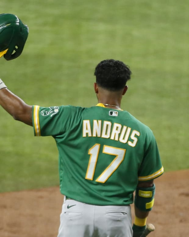 Jun 21, 2021; Arlington, Texas, USA; Oakland Athletics shortstop Elvis Andrus (17) tips his helmet before his at bat in the second inning against the Texas Rangers at Globe Life Field.