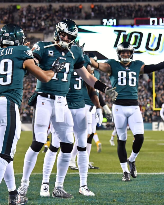 Dec 3, 2018; Philadelphia, PA, USA; Philadelphia Eagles wide receiver Golden Tate (19) celebrates his 6-yard touchdown catch with quarterback Carson Wentz (11) against the Washington Redskins during the first quarter at Lincoln Financial Field.
