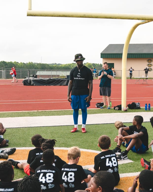 Giants linebacker Tae Crowder addresses school-aged children gathered for his recent one-day football camp held in his home state of Georgia.