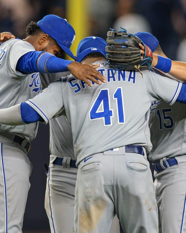 Jun 22, 2021; Bronx, New York, USA; Kansas City Royals first baseman Carlos Santana (41) celebrates with teammates after their game against the New York Yankees at Yankee Stadium. Mandatory Credit: Vincent Carchietta-USA TODAY Sports