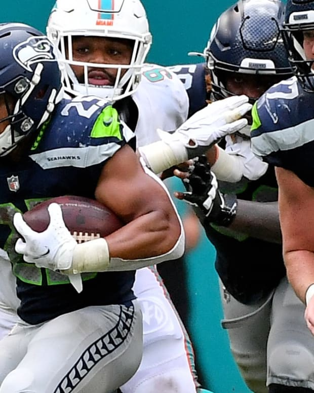 Seattle Seahawks running back Travis Homer (25) runs the ball against the Miami Dolphins during the second half at Hard Rock Stadium.