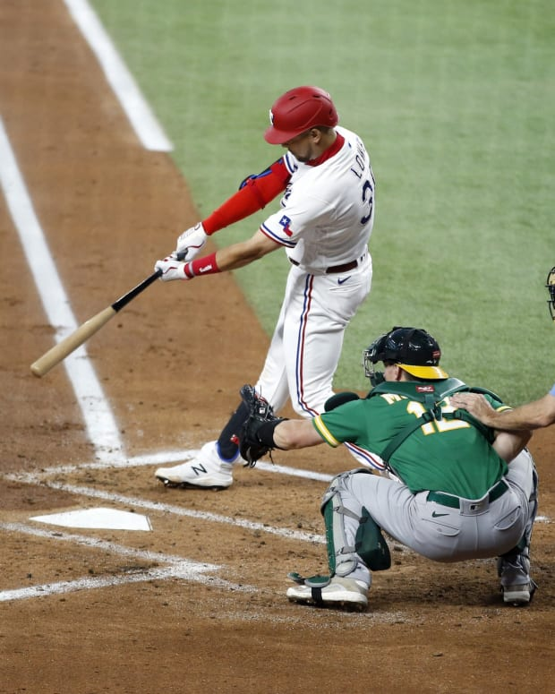 Jun 21, 2021; Arlington, Texas, USA; Texas Rangers first baseman Nate Lowe (30) hits a double in the first inning against the Oakland Athletics at Globe Life Field.