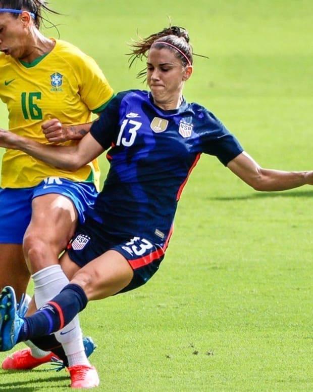 Alex Morgan, right, in action vs. Brazil
