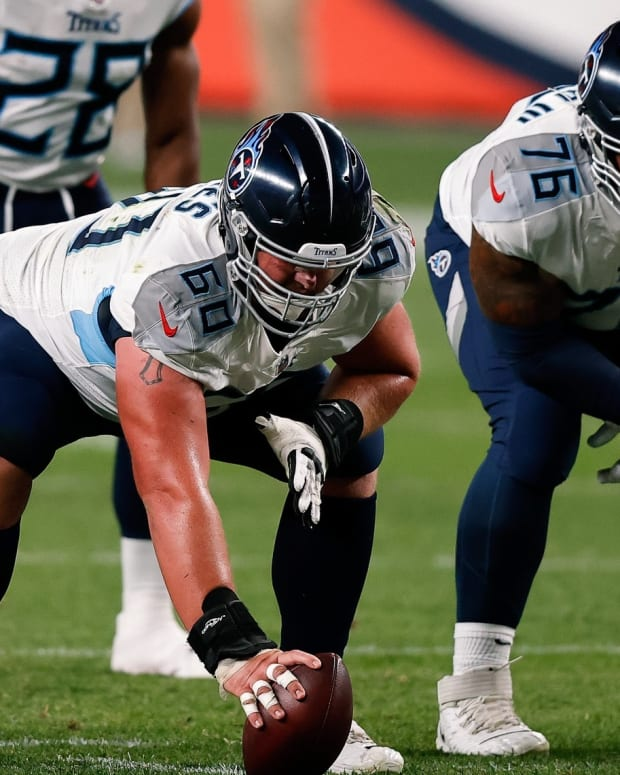 Tennessee Titans center Ben Jones (60) and offensive guard Rodger Saffold (76) in the first quarter against the Denver Broncos at Empower Field at Mile High.
