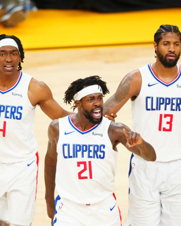Jun 22, 2021; Phoenix, Arizona, USA; Los Angeles Clippers guard Patrick Beverley (21) celebrates with Paul George (13) and Terance Mann (14) against the Phoenix Suns in the second half during game two of the Western Conference Finals for the 2021 NBA Playoffs at Phoenix Suns Arena. Mandatory Credit: Mark J. Rebilas-USA TODAY Sports