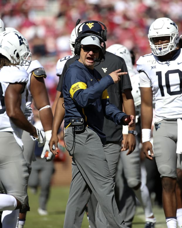 Oct 19, 2019; Norman, OK, USA; West Virginia Mountaineers head coach Neal Brown reacts during the second half against the Oklahoma Sooners at Gaylord Family - Oklahoma Memorial Stadium.
