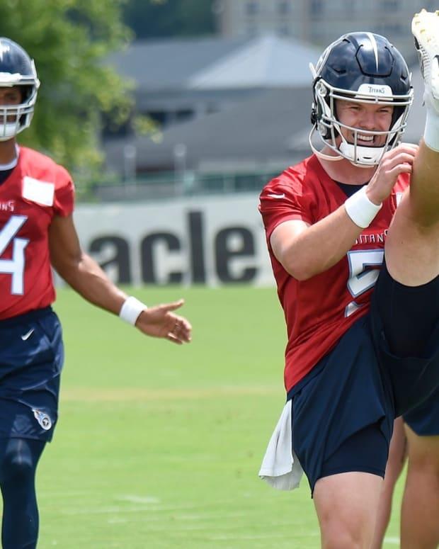 Tennessee Titans quarterbacks Logan Woodside (5) and DeShone Kizer (14) warm up during practice at Saint Thomas Sports Park Thursday, May 27, 2021 in Nashville, Tenn.