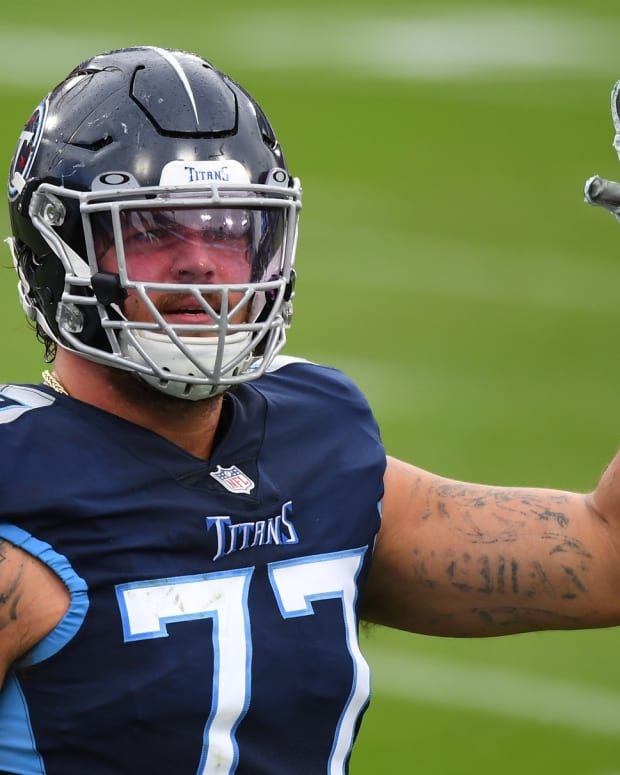 Tennessee Titans offensive tackle Taylor Lewan (77) waives in celebration after a touchdown during the second half against the Houston Texans at Nissan Stadium.