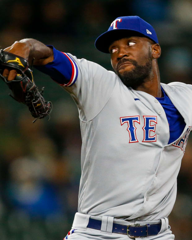 May 27, 2021; Seattle, Washington, USA; Texas Rangers relief pitcher Taylor Hearn (52) throws against the Seattle Mariners during the sixth inning at T-Mobile Park.