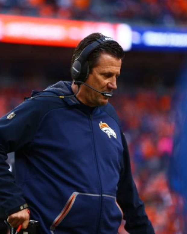 Denver Broncos quarterbacks coach Greg Knapp against the New England Patriots in the AFC Championship football game at Sports Authority Field at Mile High. The Broncos defeated the Patriots 20-18 to advance to the Super Bowl.